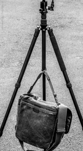 Tripod with hook to hang a stabilising weight
